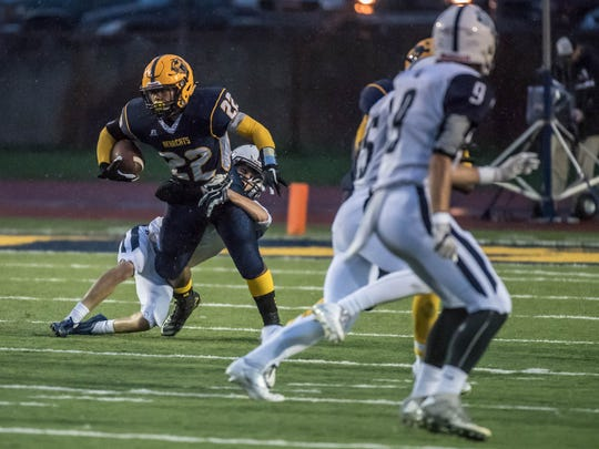Battle Creek Central's Carlos Parks (22) had 285 yards