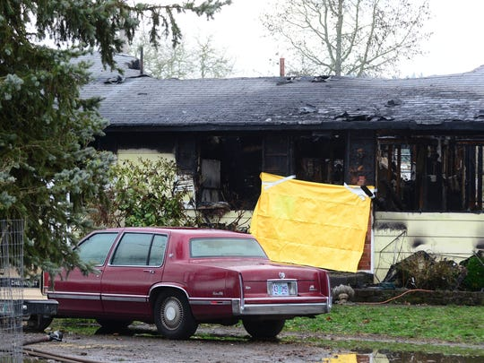 The aftermath of a house fire in the 15000 block of Jefferson Highway on Wednesday morning.The highway was closed for several hours after a body was found inside the home.