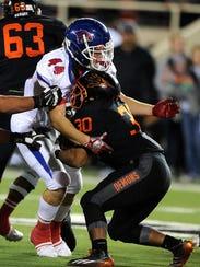 Cooper linebacker Richard Drew (44) tackles Dumas running