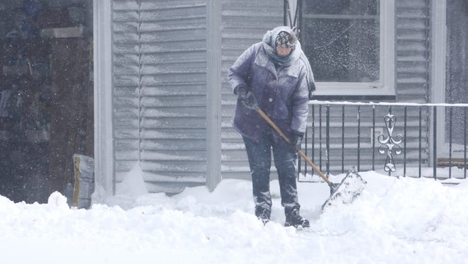 Phyllis Draycott, of Fordham Drive in Batavia, shovels her driveway last month during a storm.