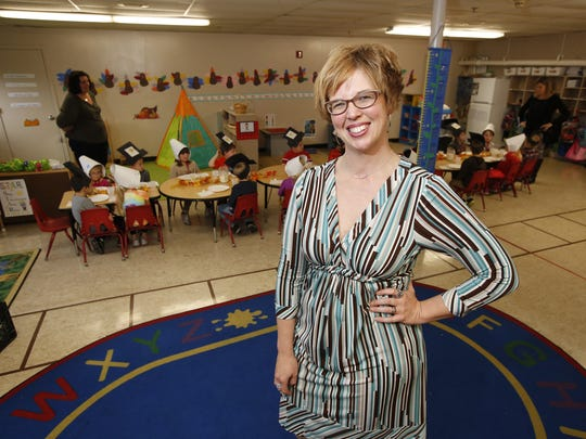 Julie Grossman poses for a photo in the child care center at the Manitowoc-Two Rivers YMCA Nov. 21, 2017.