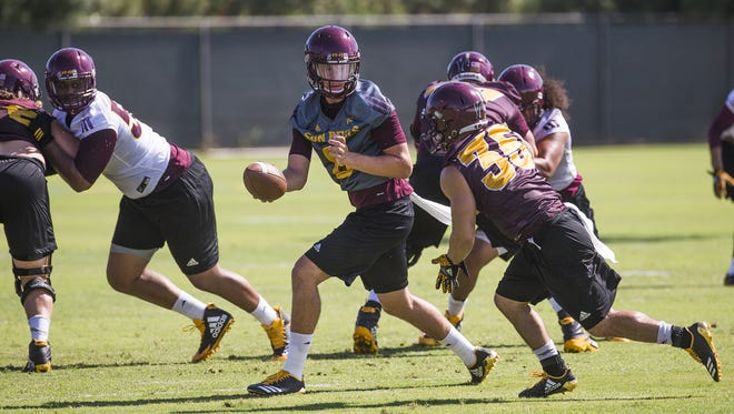 Arizona State quarterback Blake Barnett hands off during practice at ASU, Wednesday, July 26, 2017.