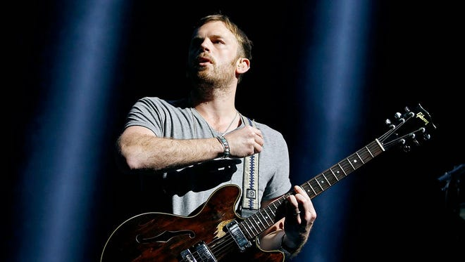 Kings of Leon perform during their Mechanical Bull Tour at Ak-Chin Pavilion in Phoenix on Wednesday, March 19, 2014.
