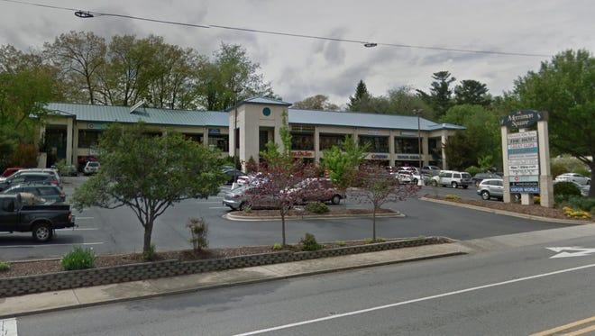 Asheville's Merrimon Square shopping center at 640 Merrimon Ave. has been sold for $5.9 million.