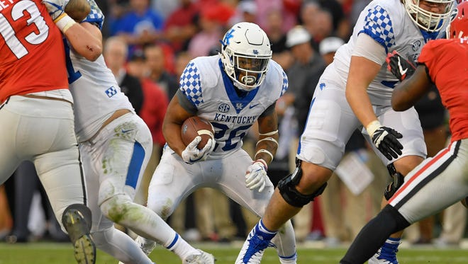 Kentucky Wildcats running back Benny Snell Jr. (26) runs against the Georgia Bulldogs during the first half at Sanford Stadium in Athens, Georgia, on Saturday, Nov. 18, 2017.