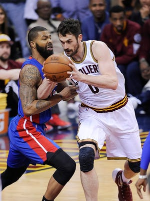 The Cavaliers' Kevin Love drives around the Pistons' Marcus Morris in the first quarter.