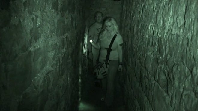 Staci and Chad Morin search for spirits at a Ghost Hunt Weekends location.