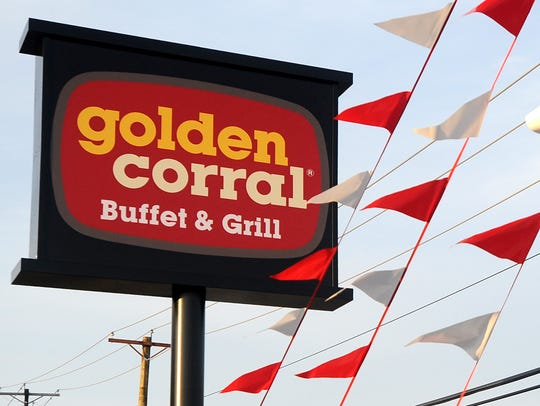 Flags herald the arrival of Golden Corral in Vineland