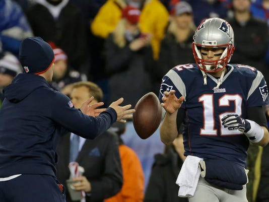 FILE - In this Jan. 18, 2015, file photo, New England Patriots quarterback Tom Brady has a ball tossed to him during warmups before the NFL football AFC Championship game against the Indianapolis Colts in Foxborough, Mass. Tom Brady is expected to file an appeal of his four-game suspension for his role in deflating footballs for the AFC championshjip game.  (AP Photo/Matt Slocum, File)