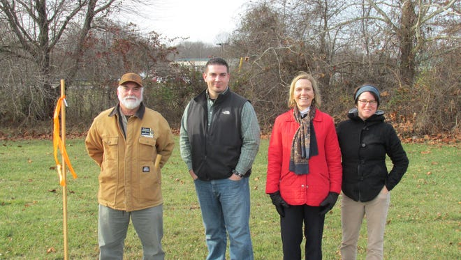 Marine Corps veteran Ronnie Hazlett (second from left) has been selected as the first participant in the state's Planting Hope with Honey Bees project. Also pictured are Delaware State Apiarist Robert Mitchell (far left); Planting Hope Project Manager Faith Kuehn; and University of Delaware assistant professor of apiculture Debbie Delaney, in the Department of  Entomology & Wildlife Ecology.