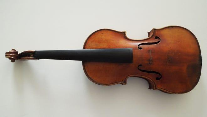 FBI New York photo of stolen Ames Stradivarius recovered in June.