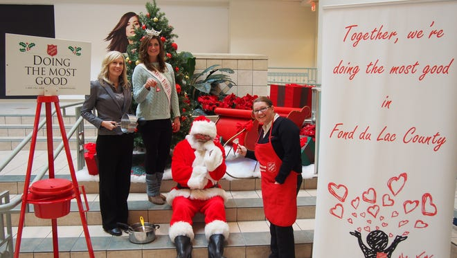 Pictured from left are: Tracy Vassallo, general manager, Simon Forest Mall; Miss Fond du Lac MacCayla Thoe; Santa and Salvation Army Captain Telinda Wilson.