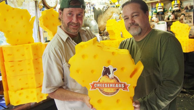John Mitchell, at right, poses with Jeff Kahlow, of Fond du Lac. Kahlow, owner of Big Guy Hats, produced some Wisconsin-shaped foam hats for Mitchell to go along with the release of the documentary. Kahlow is also featured in the documentary itself.