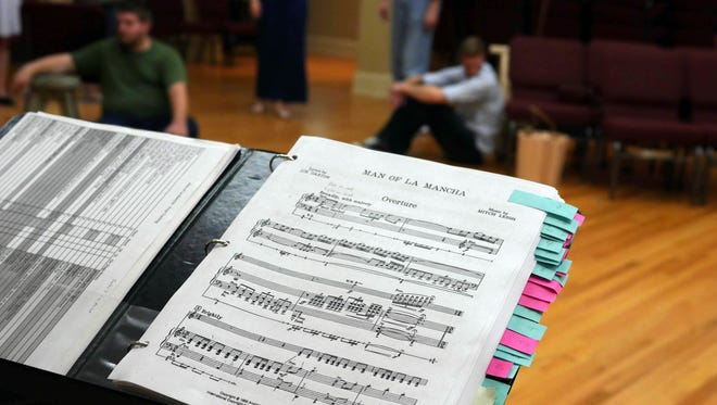 "Sheet music at a rehearsal for ""The Man of La Mancha."""