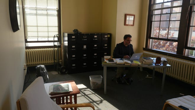 Aaron Kindsvatter, a UVM professor works in his office Wednesday afternoon. The wide-ranging purview of a team at UVM that responds to bias incidents creates a chilling effect on campus, he said.