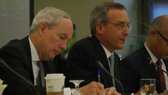 University of Vermont president Tom Sullivan, left and David Daigle, chair of the Board of Trustees.