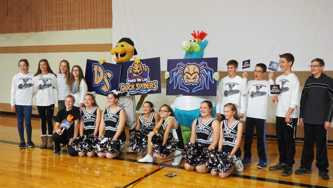 Students at Faith Lutheran School pose for a picture after the event announcing the name of the Fond du Lac Northwoods League franchise team. The Dock Spiders will start playing at the newly renovated Herr-Baker Field at Marian University in May 2017.