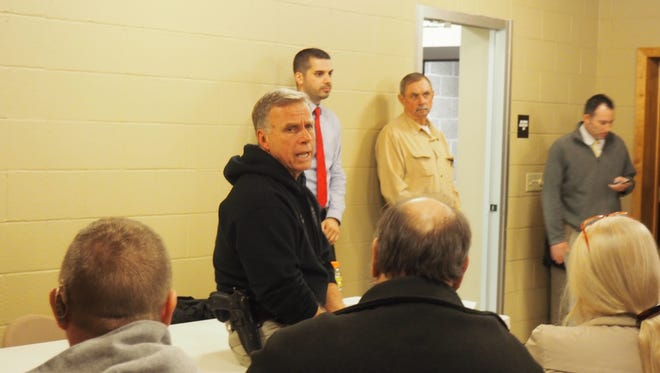 Fond du Lac County Sheriff Mick Fink talks to Eldorado residents during a public information meeting regarding the placement of violent sex offender Terry Olson Monday evening.