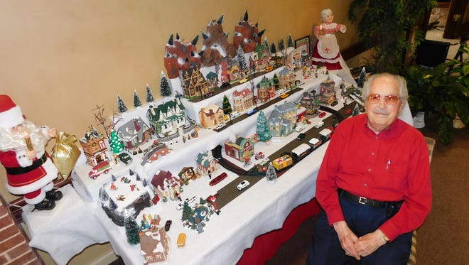 Robert W. Berry, a resident of Wesley Court Retirement Community, has set up a lighted Christmas Village display in the center's lobby for 12 consecutive years.