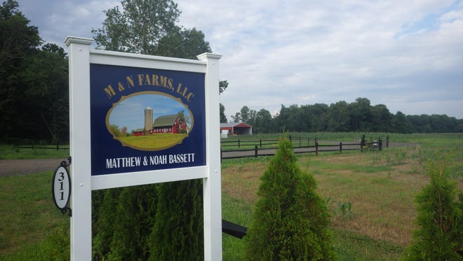 A new entrance sign identifies the M & N Farm owned by the Bassett brothers in Chesterfield and just preserved by Burlington County