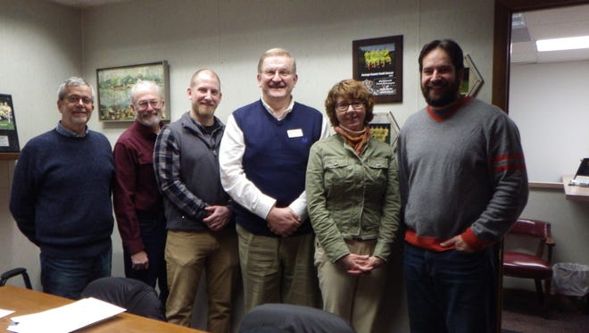 Crossways Camping Ministries staff and North Central Conservancy staff pose at the signing of the conservation easement to protect Waypost Camp on Mission Lake. From left are David Worth, NCCT president; Doug Henderson, NCCT Properties Committee; Adam Brandt, Waypost Camp director; Jake Czarnik-Neimeyer, Crossways executive director; Janet Smith, NCCT executive director; and Jacob Prater, NCCT vice president.