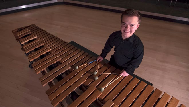 Andrew Bambridge plays the marimba, a percussion instrument with wooden bars that are struck with mallets to produce musical tones.