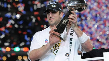 Green Bay Packers quarterback Aaron Rodgers holds the Lombardi Trophy after defeating the Pittsburgh Steelers during Super Bowl XLV in Arlington, Texas on Feb. 6, 2011.