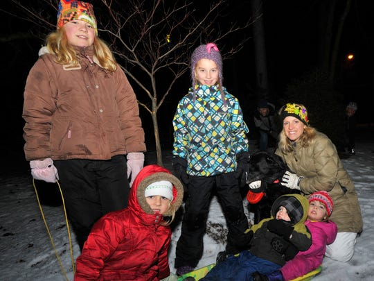 Claire Butalla, top left, Laken Ruplinger, Lynsey Seubert, Kendyl Butalla, front left, Beckett Seubert, and Annie Pease, all of Wausau, pose for a photo Friday night, Dec. 29, 2014, during an event at Robert W. Monk Gardens in Wausau.