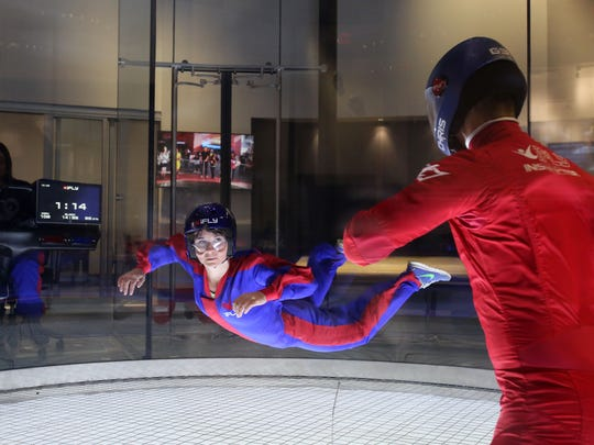 Kasey LaRue of Skydive Jersey in  Pittstown, NJ, is guided by instructor Chris Dixon during a visit to iFly, an indoor skydiving place at Ridge Hill in Yonkers, with her colleagues, Dec. 21, 2015.