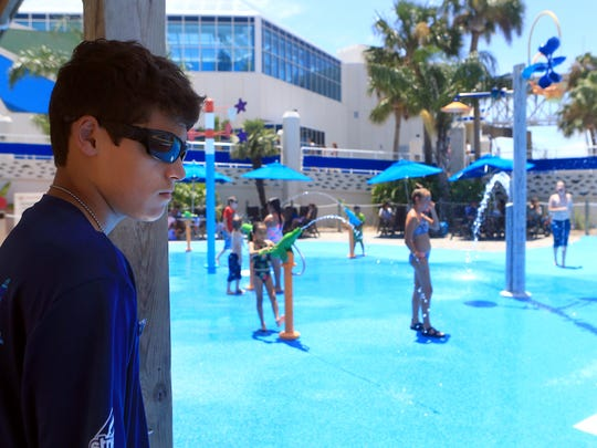 AquaTeen Jeffery Smithwick supervises guests using the water park on Friday, Aug. 28, 2017, at the Texas State Aquarium in Corpus Christi.