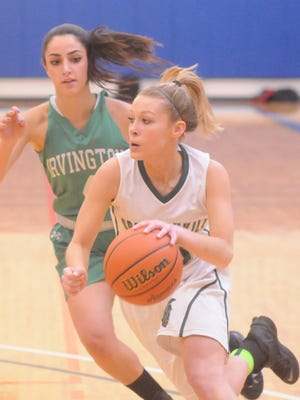 Spackenkill's Anna Thompson, right, goes for a layup while Irvington's Laura DiCamli, left, defends.