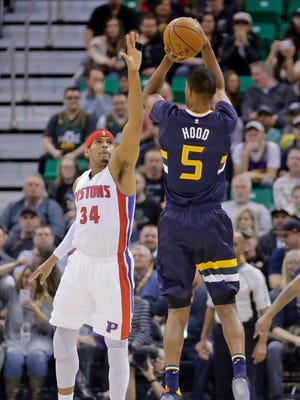 Utah Jazz guard Rodney Hood shoots over Pistons forward Tobias Harris in the first half Friday, Jan. 13, 2017 in Salt Lake City.