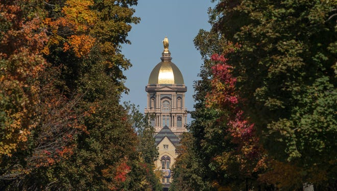 Oct 11, 2014; South Bend, IN, USA; A general view of the golden dome at the University of Notre Dame before the game between the Notre Dame Fighting Irish and the North Carolina Tar Heels at Notre Dame Stadium. Mandatory Credit: Matt Cashore-USA TODAY Sports