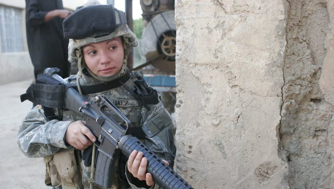A female Army specialist in 2006 in Iraq.