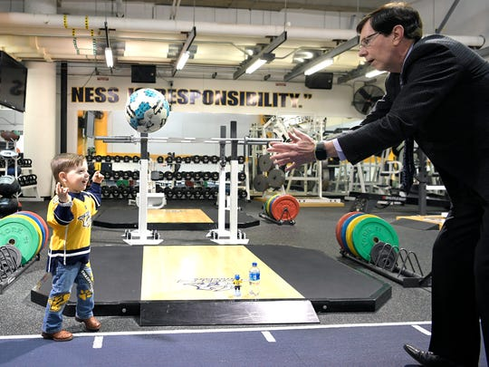 Predators General Manager David Poile play catch with his grandson, Wyatt, in the Predators'gym before a game at Bridgestone Arena on Feb. 25, 2018.