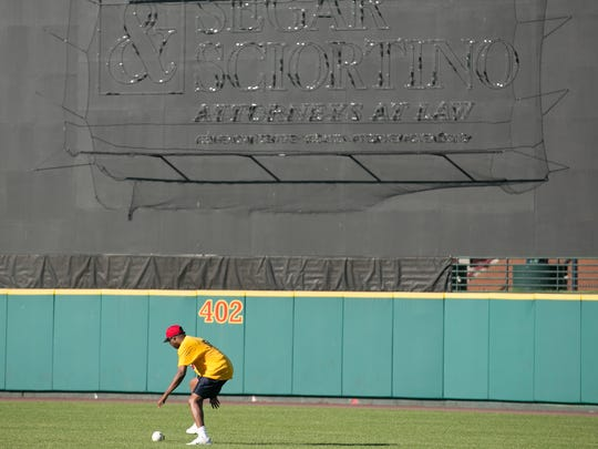 Walter Chatman III plays the field during a demonstration of Beep Baseball at Frontier Field.