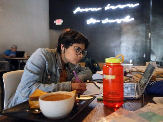 Cristy Rodriguez, a nursing student at UTEP, does homework