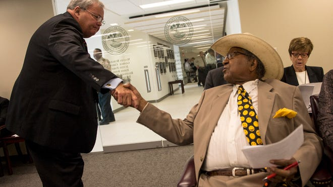 May 20, 2016 - Shelby County Sheriff Bill Oldham (left) greets SCSO community relations employee Sidney Chism during a Shelby County Commission budget and finance committee meeting. (Brandon Dill/Special to The Commercial Appeal)