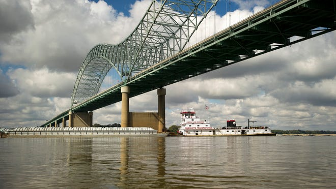 """A barge passed underneath Memphis """"M-bridge."""" A new kind of ship could revolutionize the river transportation and logistics industry."""