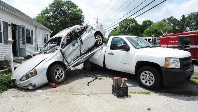 Pontiac Grand Prix ended on top of a Chevrolet Silverado, 17 100 Centre Avenue in Rockland, on July  10, 2020. Two occupants were transported to the hospital in an ambulance.