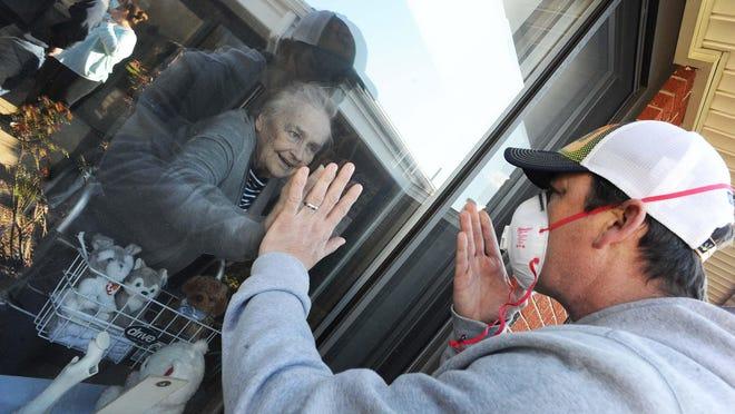 Kevin Joyce visits his mother Patricia Joyce of Brockton, who beat the coronavirus at Saint Joseph Manor Health Center on Wednesday, May 13, 2020.