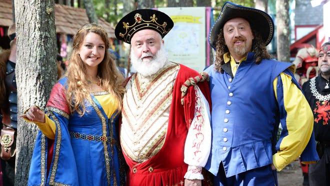 FILE - Thomas Epstein, of Carver, center, is King Richard during the 36th season of King Richard's Faire in Carver, Sunday, Sept. 17, 2017. Epstein died Wednesday, Sept. 30, at the age of 62. He is seen with Melissa Easter, of West Bridgewater, who is Princess Elizabeth' and Josh Rudy, of Randolph, who is the Master of Arms.