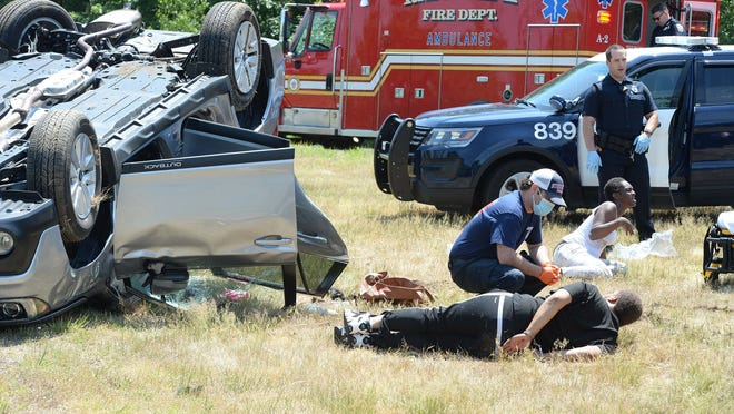 A police chase spanning two counties ended with a rollover crash at exit 20 on Route 24 northbound in Randolph on Tuesday, June 23, 2020. The police chase started in Brockton. At least one person was taken into custody and multiple people were taken by ambulance to local hospitals. Marc Vasconcellos/The Enterprise)