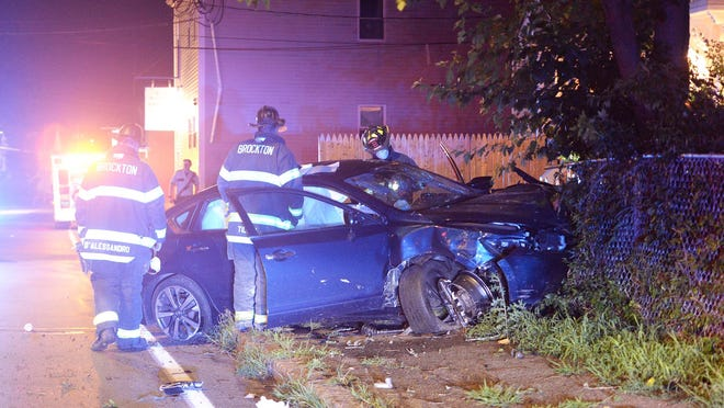 A car crashed into trash bins and a tree in front of 636 Montello Street in Brockton, on Friday, July 24, 2020 the driver of the vehicle went to a Brockton hospital in an ambulance.