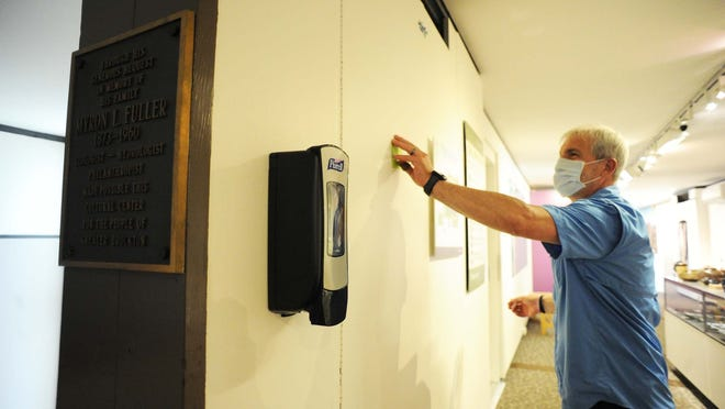 Paul Tantillo,Securities and Facilities Manager at the Fuller Craft Museum next to a hand sanitizer station on Friday, July  17, 2020 will reopen in August.
