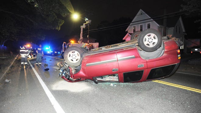 Single vehicle rollover crash after striking a utility pole on West Street in Brockton,  Saturday, Aug. 15, 2020. The driver of the vehicle fled the scene.