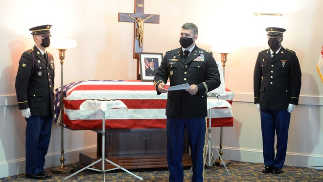 United States Army Chief Warrant Officer Kevin Connolly, 1st Sgt. Jeffrey Hyde and 1st Sgt. Walkerson Bastia honor Gold Star parents Ailina Fernandes and Eugenio Fernandes, the parents of U.S. Army Sgt. Elder Fernandes, on Friday, Sept. 4, 2020, during his wake at Russell & Pica Funeral Home on Belmont Street in Brockton. Every family member was honored with a Gold Star. Fernandes, who was missing for more than a week from Fort Hood in Texas before he was found dead in Temple, will be laid to rest in Brockton on Saturday.