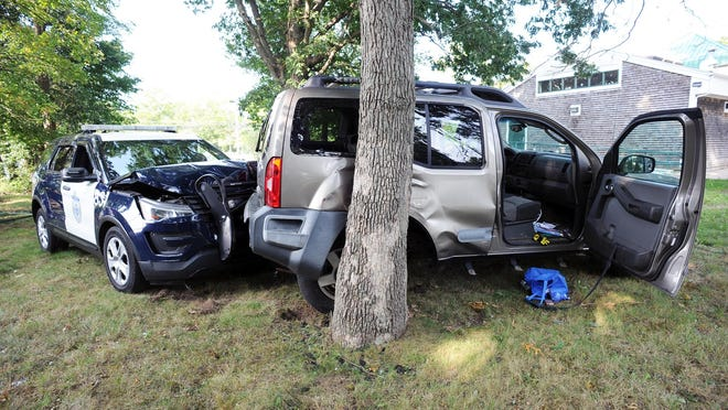 A police chase of a stolen SUV ended in a crash behind the East Side Package Store, at 469 Centre St. in Brockton, Wednesday, Sept. 16, 2020.