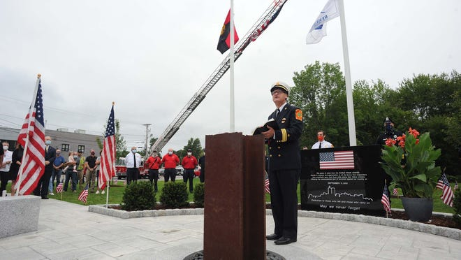Fire department chaplain Bill Smith addresses the crowd during the West Bridgewater 9/11 memorial dedication ceremony next to the fire and police station on Friday, Sept. 11, 2020.