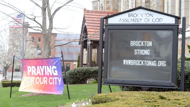"FILE - In Brockton, the Brockton Assembly of God church has two signs on its Warren Avenue property giving hope to residents. One states ""BROCKTON STRONG,"" with the other stating ""PRAYING FOR OUR CITY."""